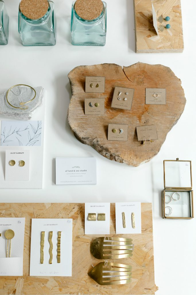 Brass jewellery on logs and wood