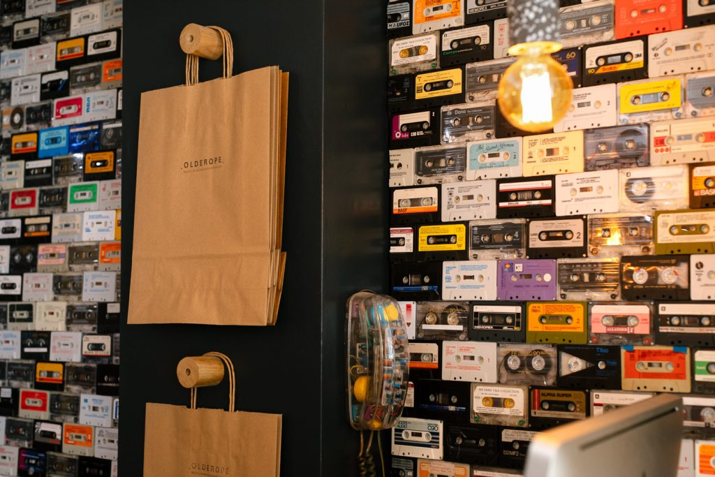 wall with paper bags and cassette tapes